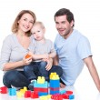 Smiling young family playing with a baby. — Stock Photo #44551901