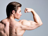 Back view of handsome man with muscular body. — Stock Photo