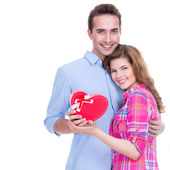 Happy young couple with a gift. — Stockfoto