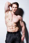 Handsome man with sexy muscular body. — Stock Photo