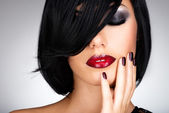 Face of a woman with beautiful dark nails and sexy red lips — Stock Photo