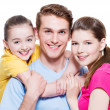 Happy smiling young family with little girl. — Stock Photo #47297761