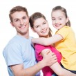 Portrait of the happy young family with child. — Stock Photo