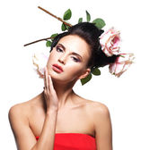 Young woman with flowers in hair. — Stock Photo