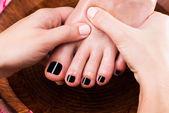 Massage of woman's foot in spa salon  — Stock Photo