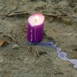 Candle on the ground — Stockfoto