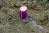 Candle on the ground — Stock Photo