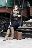 Girl waiting for landing on the platform in the vintage train — Stock Photo