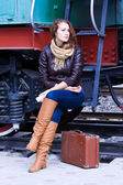 Girl waiting for landing on the platform — Stock Photo
