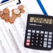 Coin, a calculator, a pen — Stock Photo #14288943
