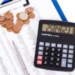 Coin, a calculator, a pen — Stock Photo