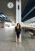 Teenage girl waiting for train — Stock Photo