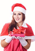 Young happy girl in Christmas hat. — Stock Photo