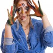Happy woman with paint smeared hands — Stock Photo