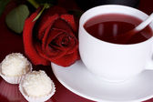 Tea, roses, chocolates — Stock Photo