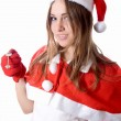 Santa young girl in Christmas hat gives car key — Stock Photo
