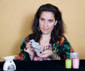 Gypsy woman sitting with cards. — Stock Photo