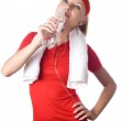 Sporty woman with water, towel and headphones — Stock Photo #29996373