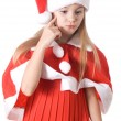 Girl in santa hat thought of the gift — Stock Photo