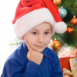 Pensive boy in santa hat — Stock Photo