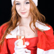 Beautiful young woman on santa hat — Photo #49279885