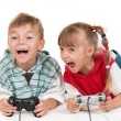 Happy girl and boy playing a video game — Stock Photo #12112893