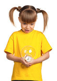 Girl with light bulb — Stock Photo
