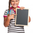 Schoolgirl with small blackboard — Stock Photo