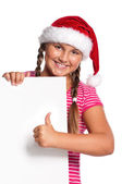 Girl in Santa hat — Stockfoto