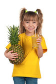 Little girl with pineapple — Stock Photo
