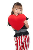 Little girl with red heart — Stockfoto