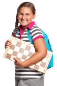 Schoolgirl with chessboard — Stock Photo