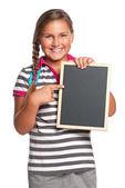 Schoolgirl with small blackboard — Stock Photo