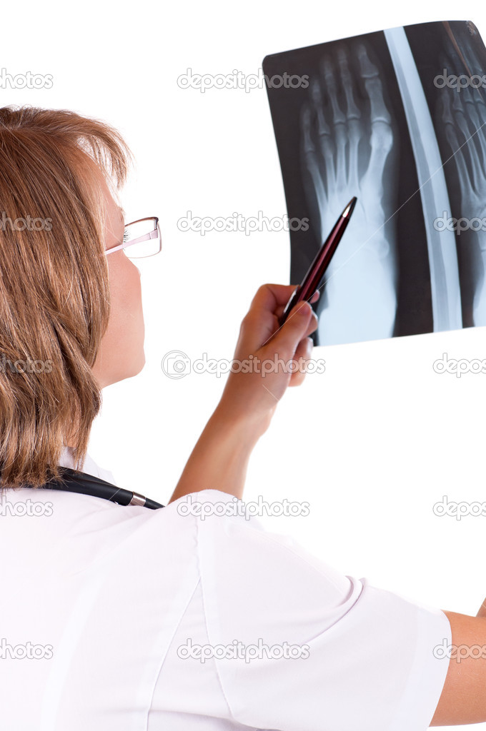 Medical doctor analysing x-ray photography isolated on white background — Stock Photo #12913858