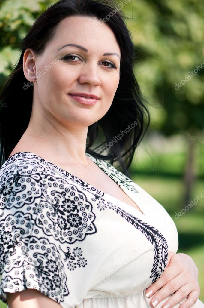 Happy pregnant woman in the park outdoors — Stock Photo #12917511