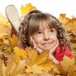 Girl with yellow foliage — Stock Photo