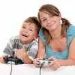Happy family playing a video game — Stock Photo #13273157