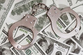 Dollars and handcuffs — Stock Photo