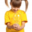 Girl with light bulb — Stock Photo #13483982