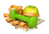 Dollars and dumbbells — Stock Photo