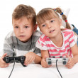 Happy girl and boy playing video game — Stock Photo #13512903