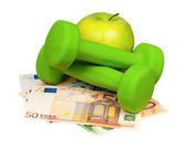 Euro and dumbbells — Stock Photo