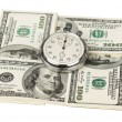 Dollars and stopwatch — Stock Photo #13605576
