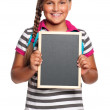 Schoolgirl with small blackboard — Foto Stock