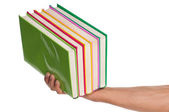 Hand with books — Stock Photo