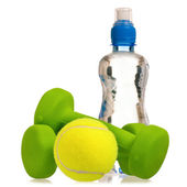 Tennis ball with dumbbells and water — Stock Photo