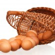 Stock Photo: Eggs in wicker basket