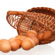 Eggs in wicker basket — Stock Photo #18556787