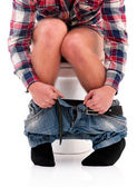 Man on toilet bowl — Stock fotografie