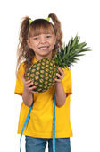 Little girl with pineapple — Zdjęcie stockowe